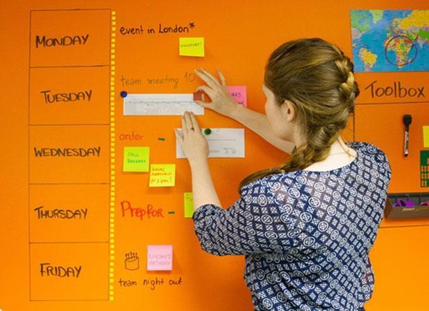 woman using smart whiteboard magnetic paint clear to plan schedule on wall